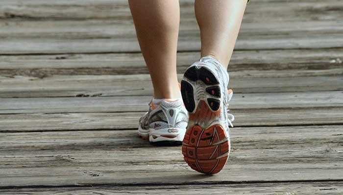 Sneakers running on the boardwalk